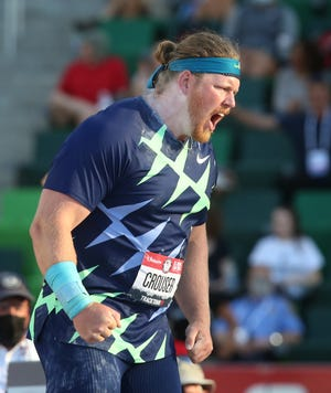 Ryan Crouser celebrates his world-record throw in the shot put at the U.S. Olympic Track and Field Trials at Hayward Field on Friday.