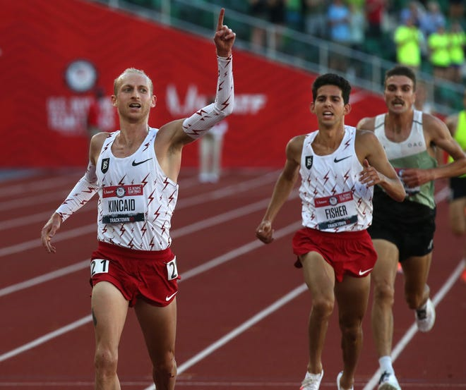 Woody Kincaid, left, wins the men's 10,000 final Friday night, followed closely by Grant Fisher in second and Joe Klecker in third during the U.S. Olympic Track & Field Trials at Hayward Field.