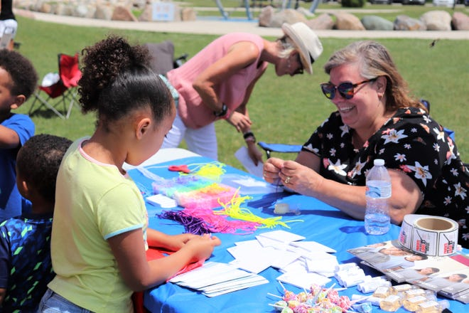 """Janet Whitfield-Hyduk, a grant coordinator with The Partnership for Drug Free St. Joseph County, leads a craft exercise during Mishawaka's """"One Day in the Sun: Take a Mental Health Day"""" event Saturday in Central Park."""