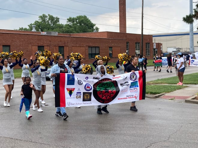 Leaders of the 2021 Springfield Juneteenth parade round the corner from Martin Luther King Jr. Drive to Adams Street as they prepare to enter Comer Cox Park on Saturday morning. The park was the site of Juneteenth festivities for the first time since 2019.