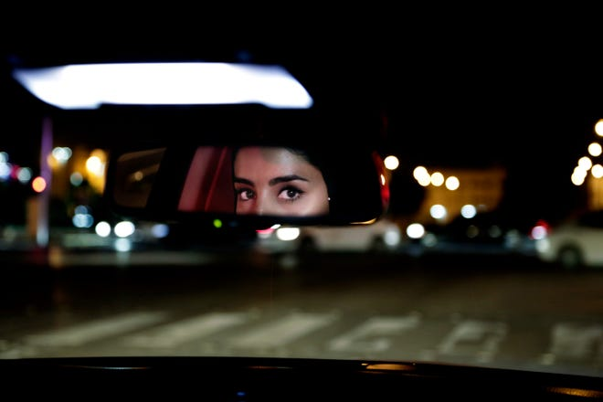 Hessah al-Ajaji drives her car down busy Tahlia Street in Riyadh, Saudi Arabia, early on June 24, 2018, just minutes after the world's last remaining ban on women driving was lifted.