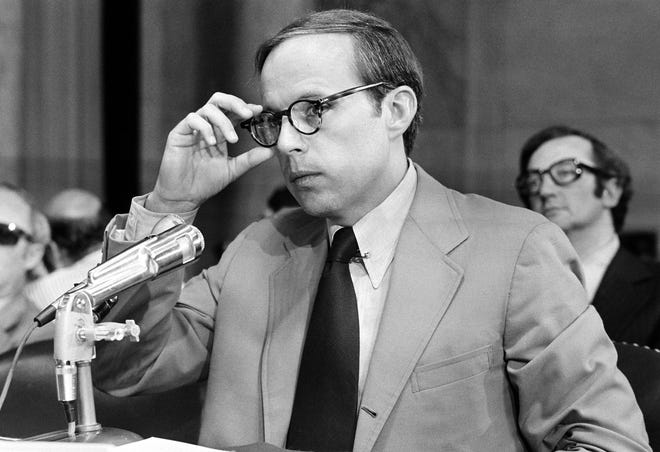 John Dean III, former White House aide in the Nixon administration, adjusts his eyeglasses as he nears the end of reading his 245-page prepared statement before the Senate Watergate Committee in Washington, D.C., on June 25, 1973.  In his seven-hour opening statement Dean said that the president was involved in the cover-up of the Watergate burglary.