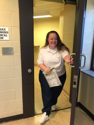 Jennifer McMullan walks out of the McHenry County Correctional Center a free woman Wednesday.