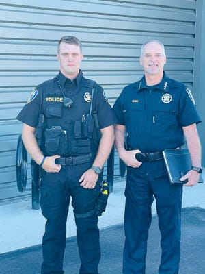 Tyler Bertolucci, a 2015 Weed High School graduate from Grenada, left, was sworn in as a Yreka Police Officer on Wednesday. On the right is Yreka Police Chief Mark Gilman.