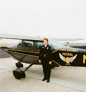 Lt. Col. Marla Gaskill and her plane.