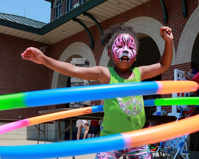 Harmanie Wilson plays with hula-hoops at the Juneteenth celebration, Saturday, June 19, at Harry E. Kelley Park. Harmanie is the 7-year-old daughter of Eric Wilson.