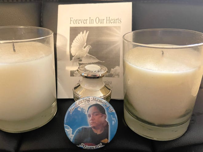"""A home memorial includes candles and a small keepsake urn, which should have contained the cremated remains of Anna Zuniga, 49, of Victorville, who died earlier this year. Instead, the urn, and several others given to Zuniga's family, contained """"residue"""" from the cremation chamber following a mislabeling, according to Sunset Hills Memorial Park and Mortuary in Apple Valley."""