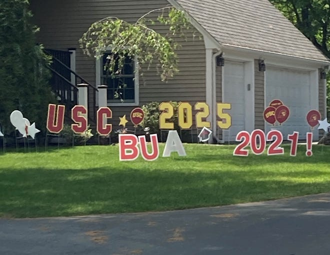 A picture of celebratory yard signs, an environmentally friendly alternative to balloons.