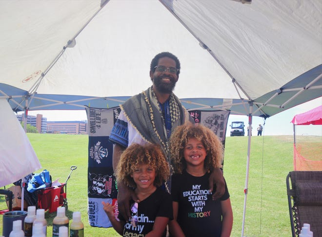 Herschel Schoates posed daughters Avery Rayn and Gabrielle at Juneteenth for the Crest event at Cole Park Amphitheater