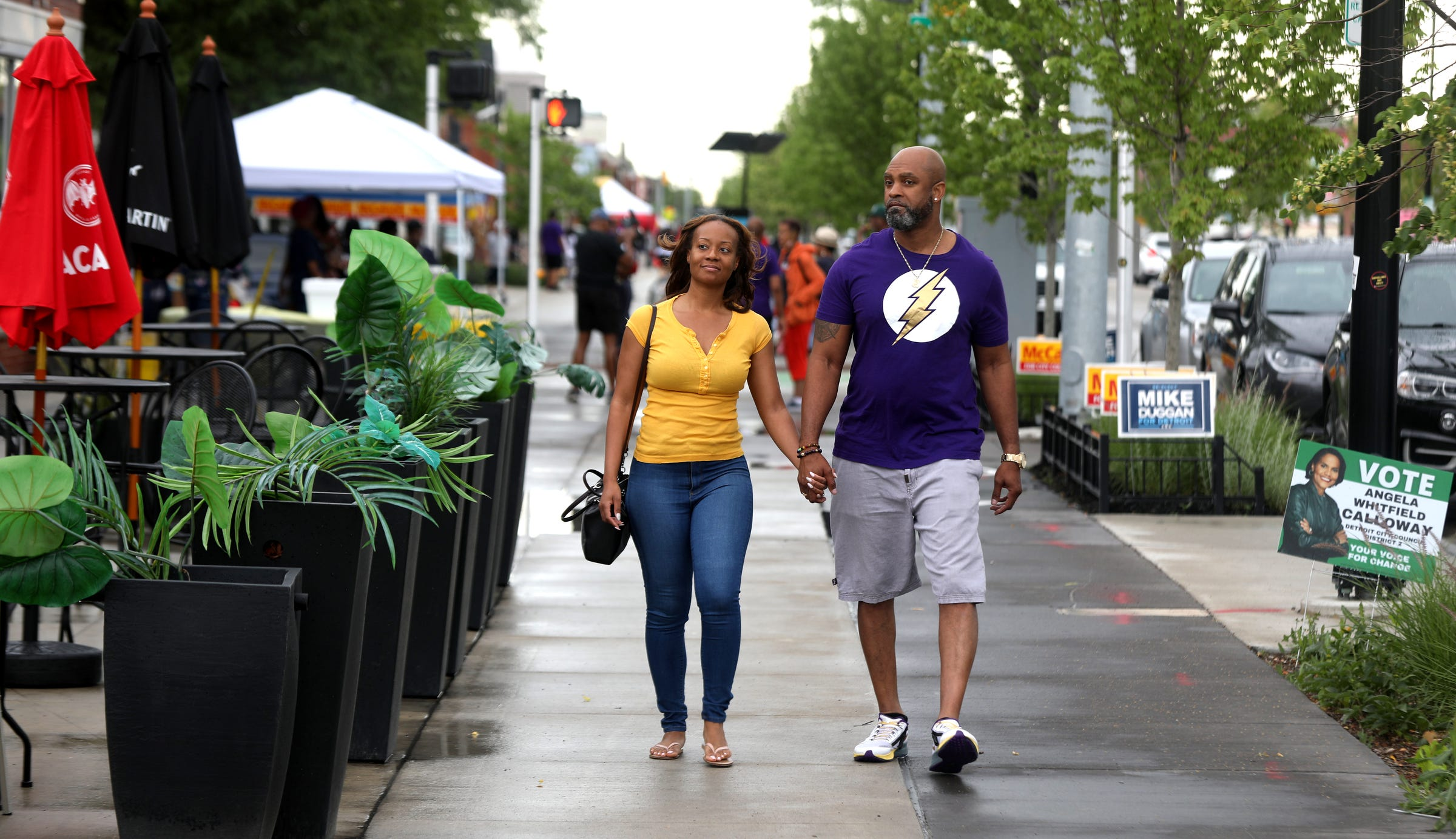 (L to R) Tiffany and Damon Kimbrough of Southfield walk and window shop during Juneteenth celebrations on the Avenue of Fashion on Livernois in Detroit on June 19, 2021.