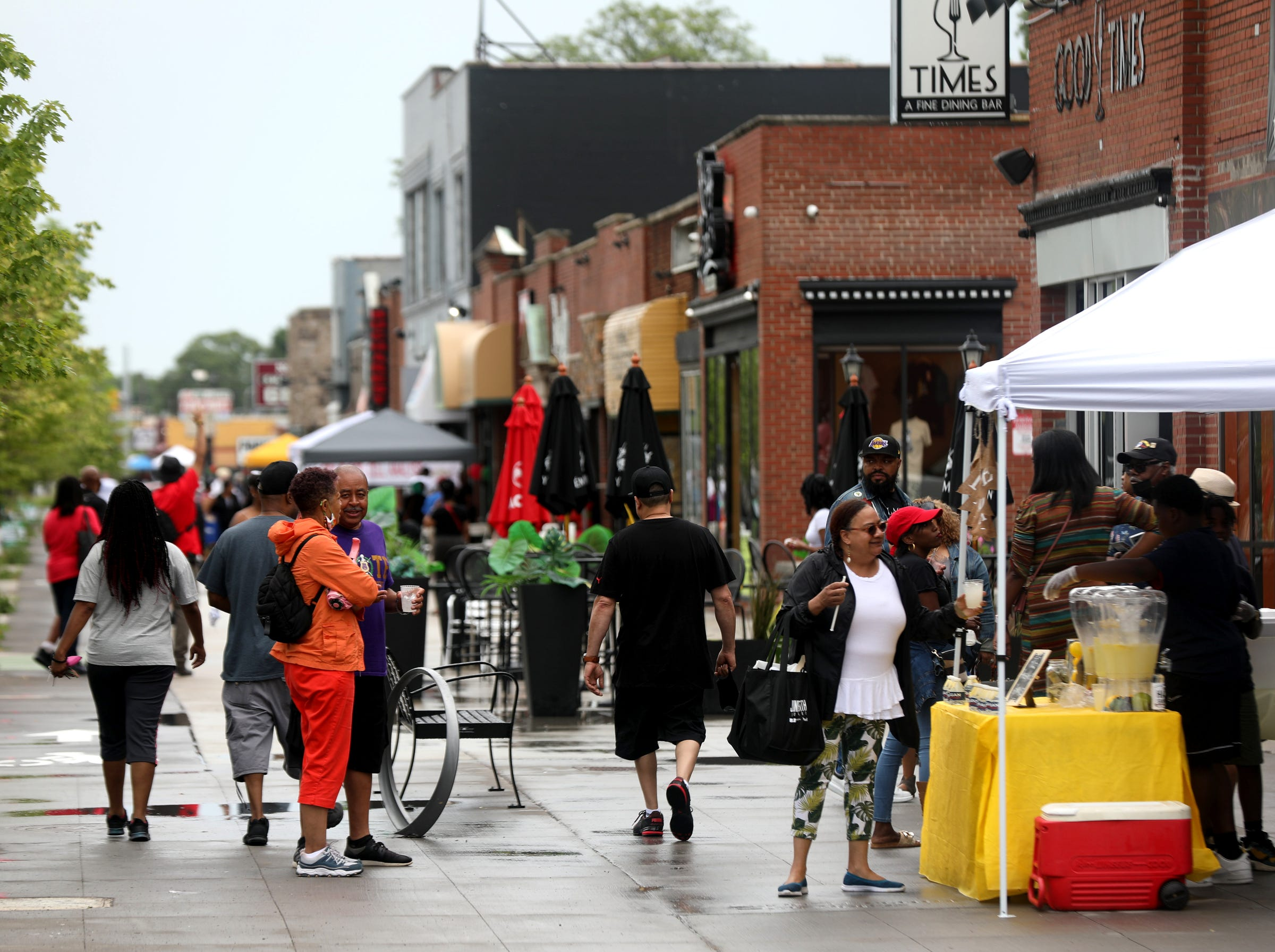 People walk and shop during Juneteenth celebrations on the Avenue of Fashion on Livernois in Detroit on June 19, 2021.