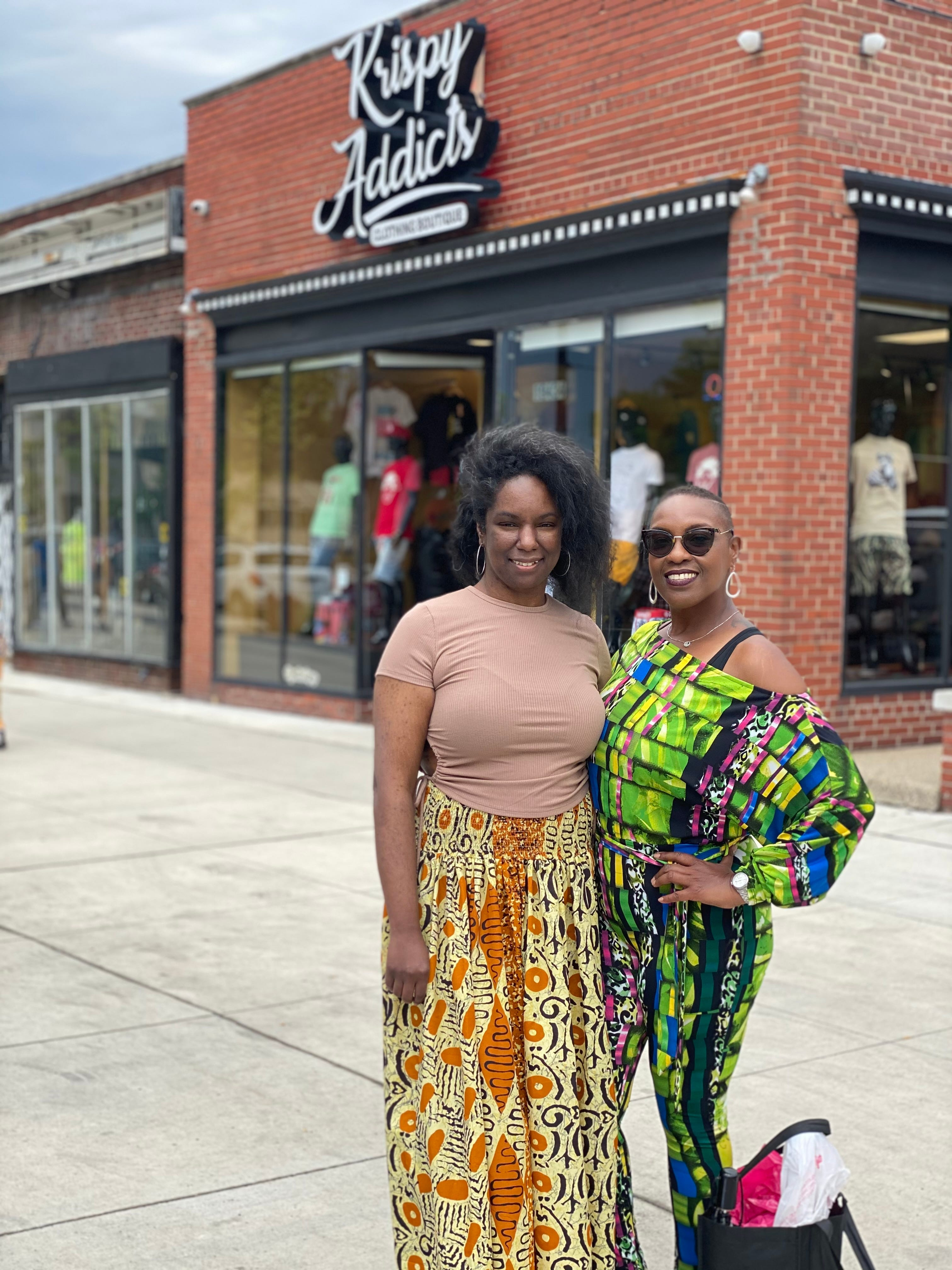 Sisters, Teresa Johnson, 41 on the left and Kalimah Johnson, 52, on the right poses while shopping on the Avenue of Fashion in Detroit for the Juneteenth Jubilee.