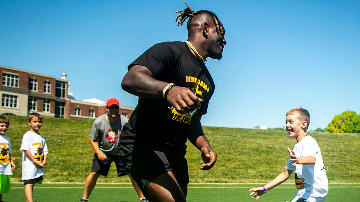 Photos: Desmond King hosts free youth football camp on Juneteenth at Iowa City High