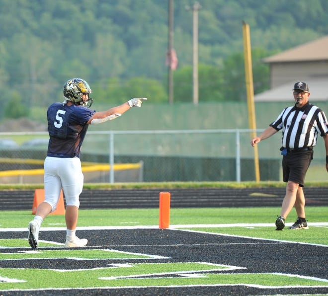 Colonel Crawford's Tristan Cross points to his line after blocking for him to rush in the game-winning touchdown for the South.