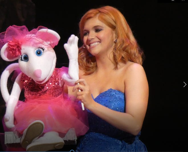 """Miss Miami Valley Mackenzie Perry of Nelsonville won the Friday night Miss Ohio preliminary talent award for her ventriloquism act. She performed """"The Girl in 14G"""" with puppet Izzy the mouse at the Renaissance Theatre."""