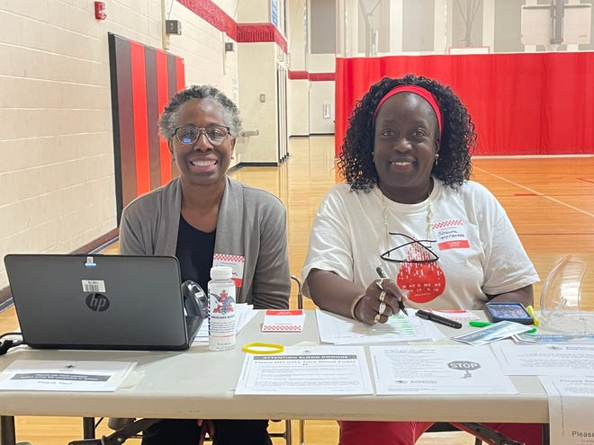 (Left to right): Lora Troutman and Shawna McNamara checked people into the blood drive on Saturday morning at the YMCA in Marion.