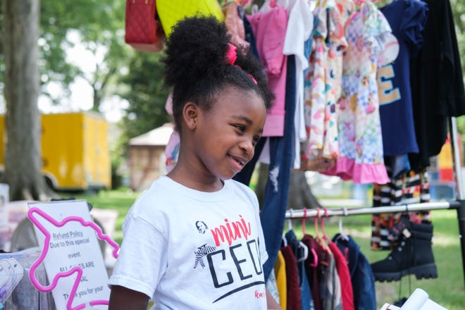 Ilana Kai, 7, CEO of Kai's World Kloset, discusses some of the items she is selling at the Juneteenth celebration on Saturday, June 19, 2021, in Memphis, TN.