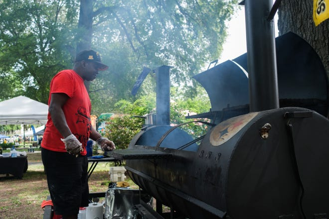 Vincent Jamerson smokes meat during the Juneteenth celebration at Health Sciences Park, Saturday, June 19, 2021, in Memphis, TN.