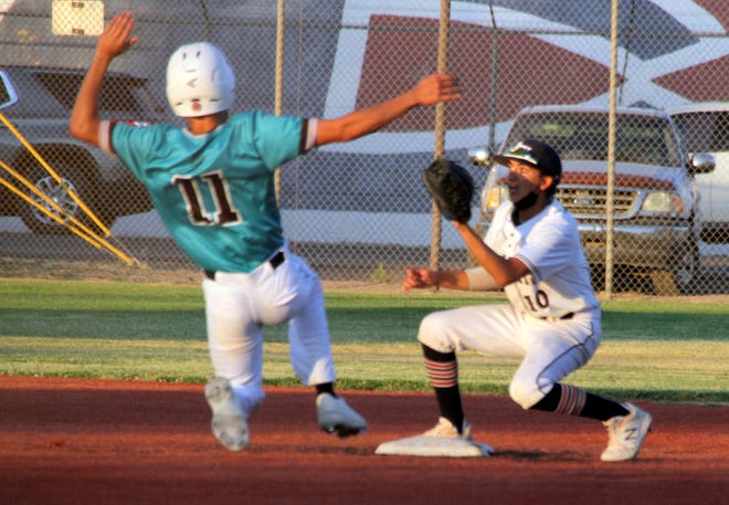 Senior Anthony Almanza (10) records the putout at second base on an attempted steal by Oñate  base runner Jimmel Cogles (11). The Oñate  High Knights swept the Deming Wildcats Friday night, 4-0 and 12-1, to claim the District 3-5A Baseball Championship.