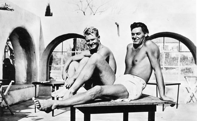 Johnny Weissmuller (right), who won five gold medals swimming in the Olympics, and Mickey Riley, platform and springboard diver, who won four Olympic medals, pictured at the El Mirador pool in 1940.