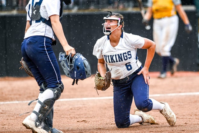 Marysville's Kirsten Smith, right, celebrates with Anna Oles after Smith made a diving catch for an out against Owosso in the third inning on Saturday, June 19, 2021, during the Division 2 final at Secchia Stadium on the MSU campus in East Lansing.