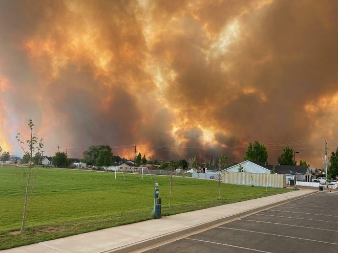 The Flatt Fire was started by lightning Friday afternoon in Beryl and quickly grew to some 6,000 acres in the direction of Enterprise, forcing widespread evacuations.