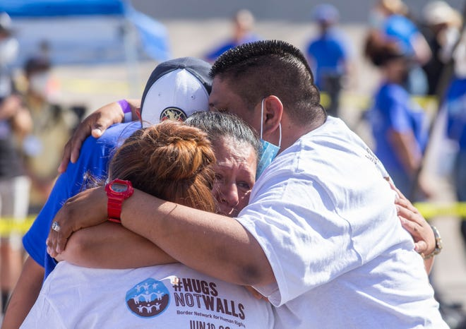 """A woman who resides in the U.S. is embraced by her Mexican family during the 8th annual """"Hugs not Walls"""" event which allowed Mexican immigrants with irregular status in the U.S., and unable to return to Mexico, an opportunity to meet with family for a few minutes on the international border on the Rio Grande between Ciudad Juarez, Mexico and El Paso, Texas."""