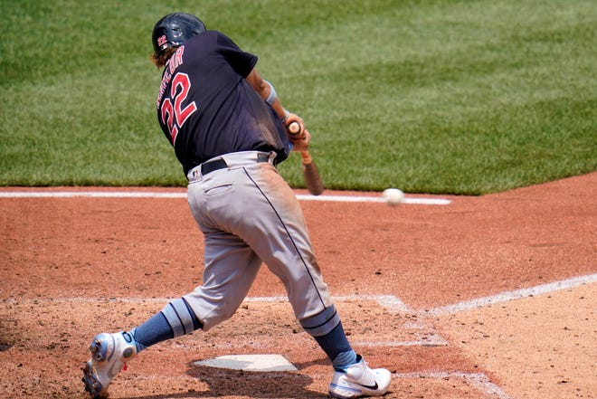 Cleveland's Josh Naylor singles off Pittsburgh Pirates relief pitcher Chasen Shreve, driving in a run, during the seventh inning of a baseball game in Pittsburgh, Sunday, June 20, 2021. (AP Photo/Gene J. Puskar)