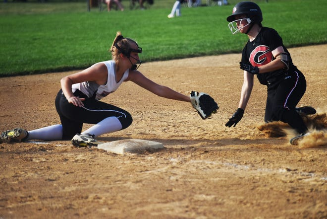 Roland-Story third baseman Lydia Oetker gets ready to tag out Gilbert's Emma Mostek at third in the top of the sixth inning during the Kiwanis Invitational game between the two former Heart of Iowa Conference rivals Saturday in Roland. Gilbert won by a 3-1 score.