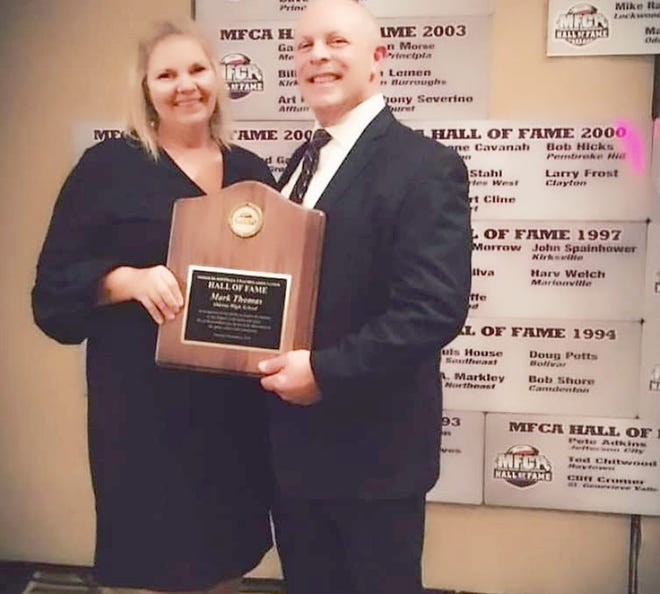 Mark Thomas, a 1975 graduate of Boonville High School, will be the featured speaker for the Boonville Alumni Celebration on Saturday, June 26 at Knights of Columbus in Boonville. Thomas stands with his wife, Judith, after being inducted into the Missouri Sports Hall of Fame in 2020.