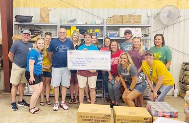 On Thursday, June 17th, members of the Veterans United Home Loans team from Columbia visited Boonville's Neighbors Helping Neighbors on 509 Water Street.  The VU team helped the pantry with various food preparation tasks, and also surprised NHN Board President Cindy Newton with a check for $5,000 from the Veterans United Foundation.  The money will go to assisting NHN with providing meals and food supplies support to Boonville families.