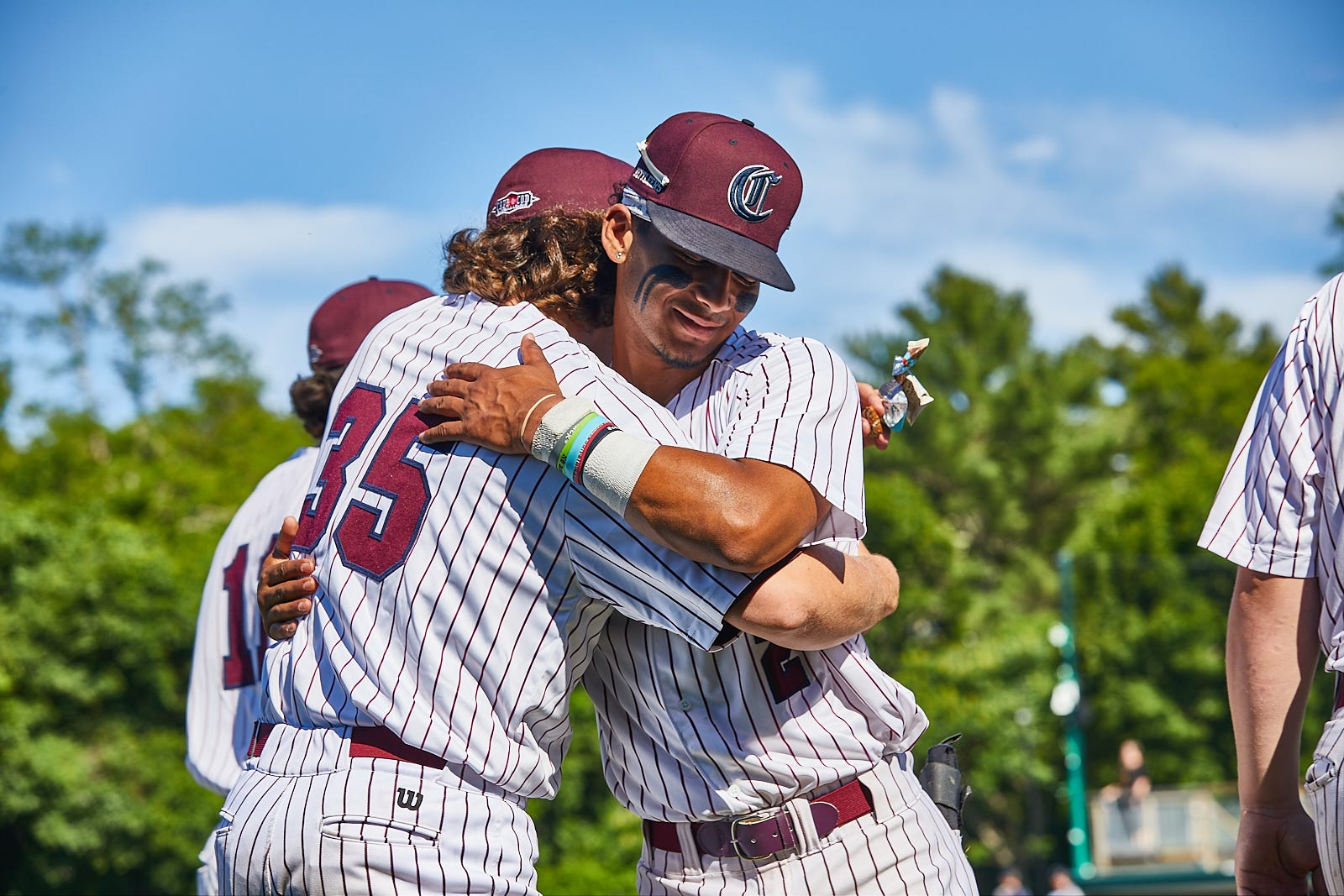 COTUIT - 06/20/21 -- Cotuit Kettleers, Alaska Abney, from Lawrenceville, GA, and Eric Brown, from Bossier City, LA, embrace before the start of the Cape League opener at Lowell Park against Wareham.