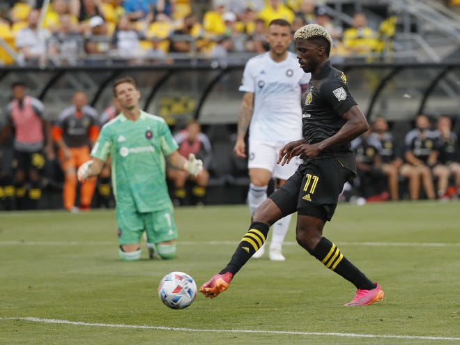 Columbus Crew forward Gyasi Zardes (11) taps in a goal, his second of the half, into a wide open net as Chicago Fire goalkeeper Bobby Shuttleworth (1) was out of the box during the first half of the final Columbus Crew game at Historic Crew Stadium in Columbus on Saturday, June 19, 2021.