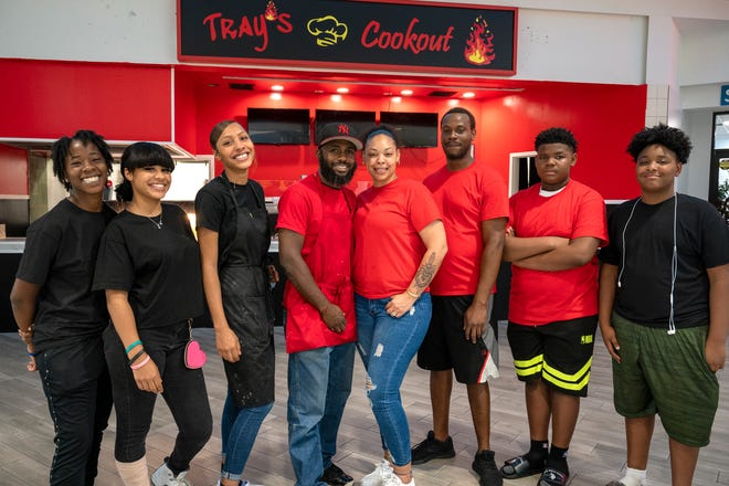 Trayon Lewis and his wife, Michelle Perez (center), and his crew run Tray's Cookout at the Lake Square Mall in Leesburg.