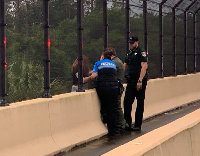 A Flagler County deputy quickly grabbed the hand of a suicidal girl about to jump off an Interstate-95 overpass on Sunday. The girl was then safely lowered from the overpass, officials said.