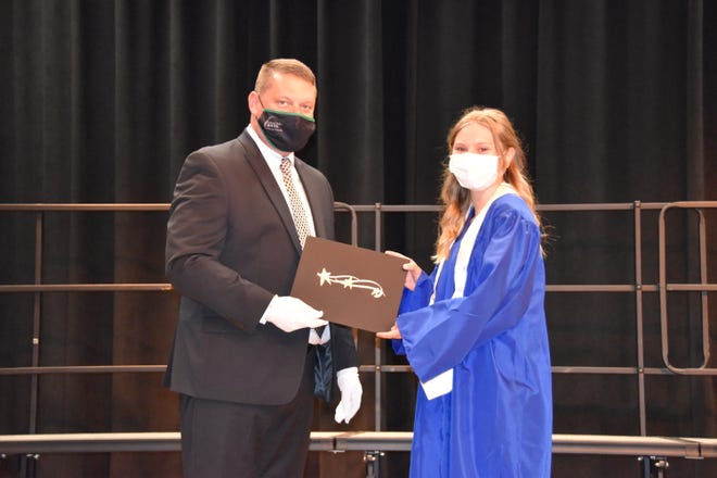 JoAnna Regatuso (right) receives the 2021 Dr. Charles Holowach Memorial Scholarship from Matthew Flowers, GV BOCES Mount Morris Campus Executive Principal (left). JoAnna is an Agricultural Production student from Mount Morris CSD.