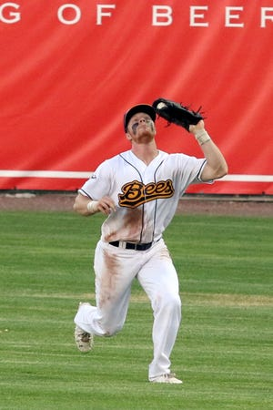 Burlington Bees' Rome Wallace catches a fly ball in short right field for an out against the O'Fallon Hoots Saturday at Community Field.