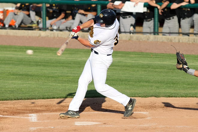 Burlington Bees Austin Simpson connects with the ball against the O'Fallon Hoots Saturday at Community Field.