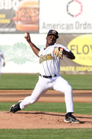 Burlington Bees starting pitcher Jalen Evans fires a pitch to an O'Fallon Hoots batter Saturday at Community Field.