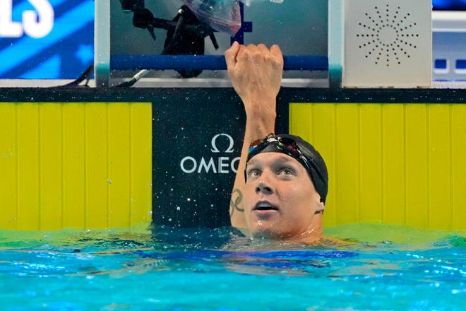 Caeleb Dressel reacts after the men's 100m butterfly finals during the U.S. Olympic Team Trials swimming competition at CHI Health Center Omaha.