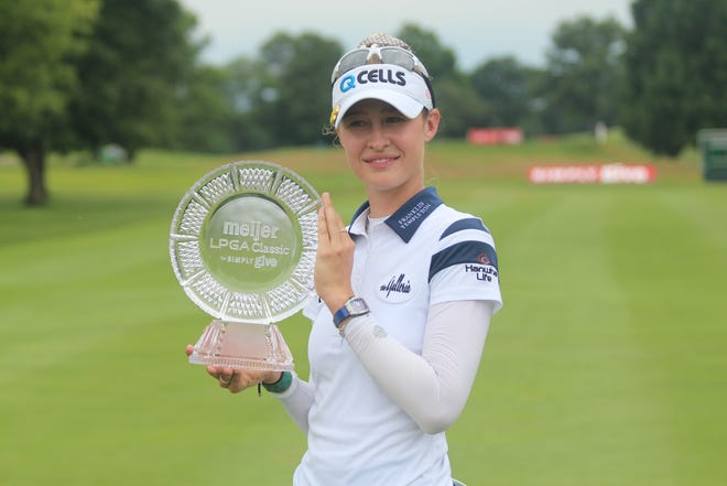Nelly Korda poses with the Meijer LPGA Classic trophy after the final round