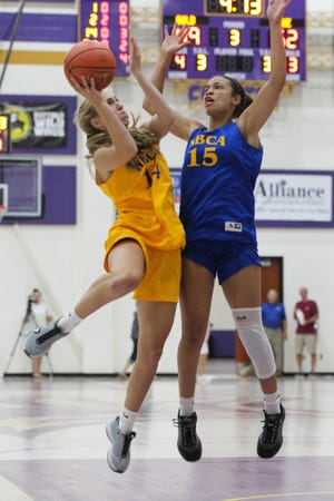 Bucklin's Catherine Bowman (14) collides in mid-air with Osawatomie's Amiah Simmons (15) during the KBCA all-star game Saturday at Mabee Arena in Salina.