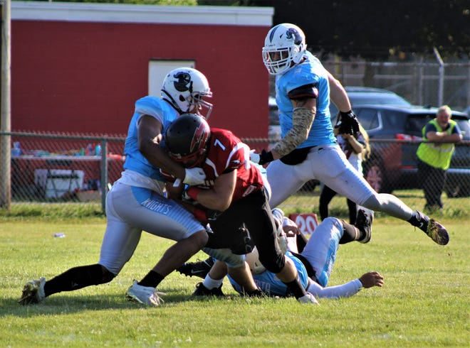 Southeast Michigan Red Storm receiver Mike Batwinas (7) is tackled by Rhonald Houston of the Findlay Knights during a 28-14 loss Saturday night.
