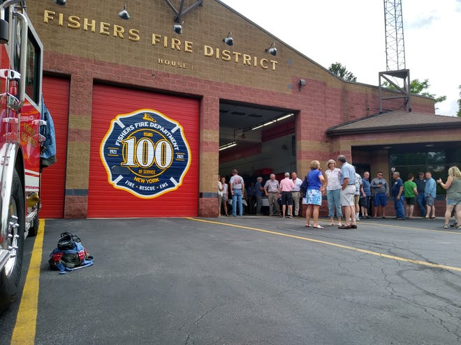 The Fishers Fire District Station, on 7853 Main St. Fishers in Victor played host to a gathering celebrating 100 years of service for the community. In honor of the station's longevity, a new logo was designed highlighting the length of time the district's been in operation, shown here on the door.