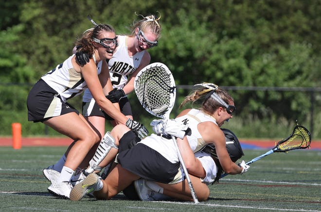 The celebration is on after North Kingstown defeated Portsmouth to win the Division II girls lacrosse championship on Sunday afternoon at Cumberland High School.