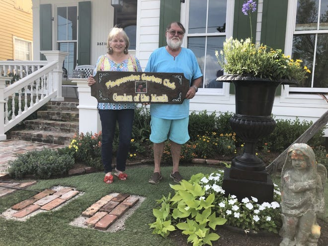 The quaint cottage home of Marty and Tarra Lyall Landry has been chosen as the Plaquemine Garden Club Garden of the Month for June.