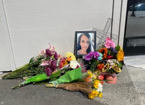 A memorial to Jennifer Davidson, 47, outside the Herbal Choices marijuana dispensary branch in North Bend on Saturday. She was the store's manager and one of three people allegedly killed the day before by Oen Nicholson, who surrendered in Wisconsin.