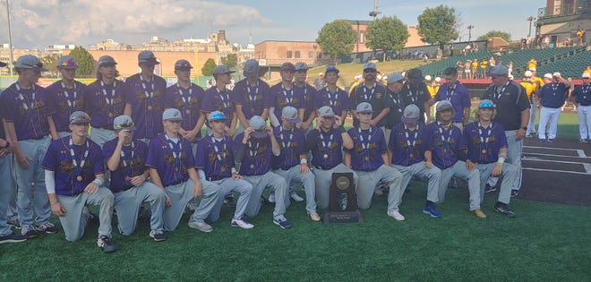 Hononegah coaches and players pose with their fourth-place trophy from the state Class 4A baseball tournament in Joliet on Saturday.