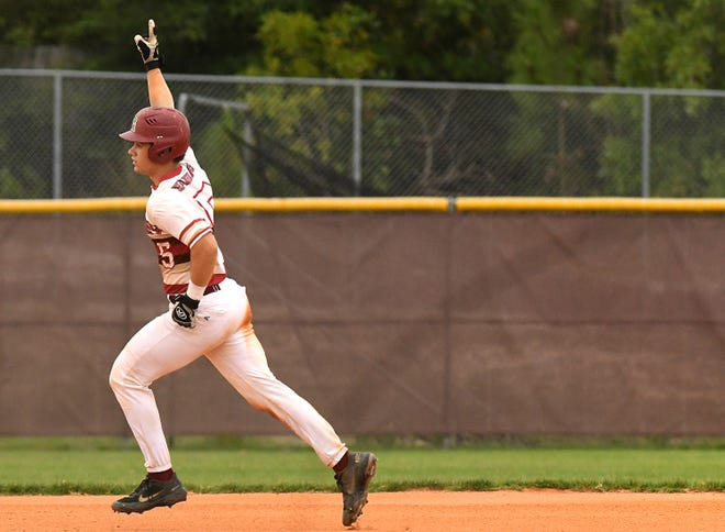 Ashley's #5 Drew Tyndall rounds 2nd after hitting a homerun as Ashley took on Purnell Swett in the playoffs Saturday June 19, 2021 in Wilmington, N.C. Ashley won 8-6. [KEN BLEVINS/STARNEWS]