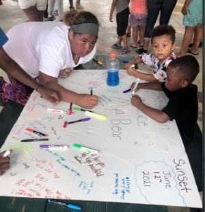 """People who knew her got a chance to write out messages to 13-year-old gunshot fatality victim DaMya Hudnall, lovingly referred to as """"Mya Bear,"""" during an event held Saturday to honor her memory."""